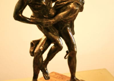Fighters, bronze, polished wood, brown patina by © MariAnna MO Warr