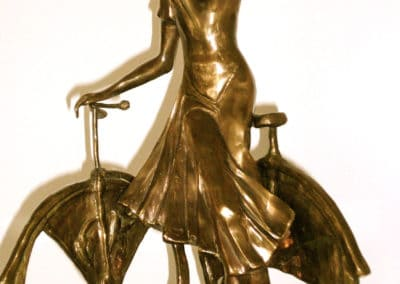 Young Lady & bicycle, bronze,black marble, brown patina by © MariAnna MO Warr